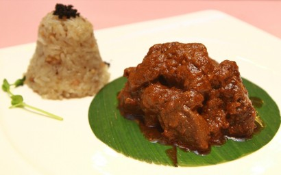 The tender braised curry beef shank served with glutinous rice topped with a pinch of caviar.