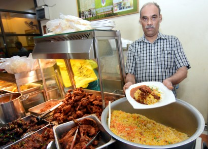 Top seller Thajudeen with Restoran Tajudin Nasi Briani's best-seller, nasi briyani with fried chicken.