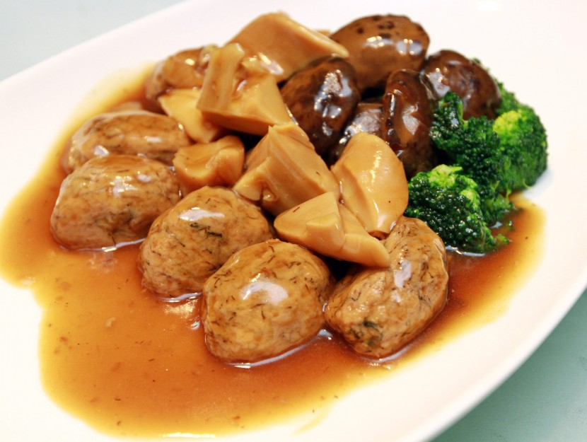Tasty: Braised Top Shells with stuffed Oysters, Mushrooms and Abalone Sauce.