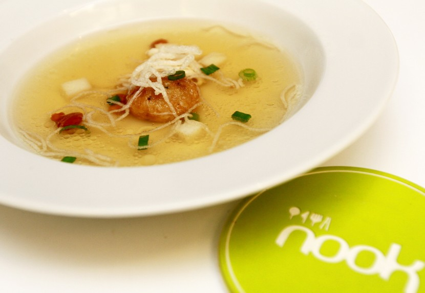Creamy goodness: The Indonesia-inspired Chicken Soto Consomme is a light pale yellow chicken with buttery bergedel.