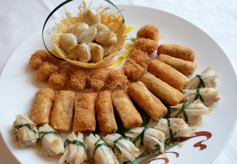 For prosperity: The Fortune Combination Platter consists of Dragon Beard Prawn Tube, Stuffed Fresh Scallops, Kwei Fei Dumplings and Banana Seafood Roll.