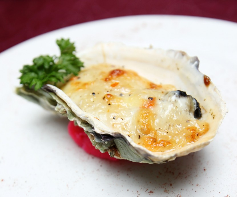 Cheesy : The Oven Baked Live Oyster goes well with the cheese.