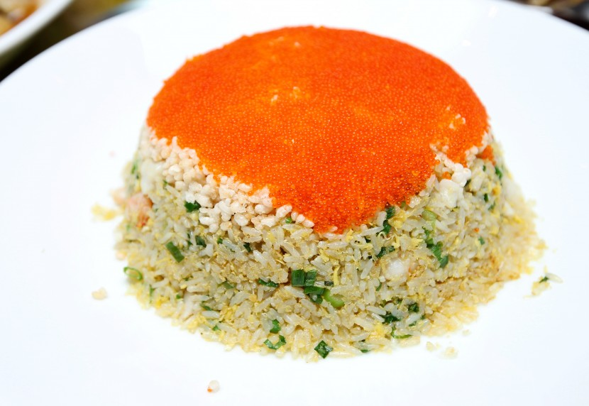 Colourful: The Fried Rice with Seafood and Rice Crackers is topped with crab eggs.