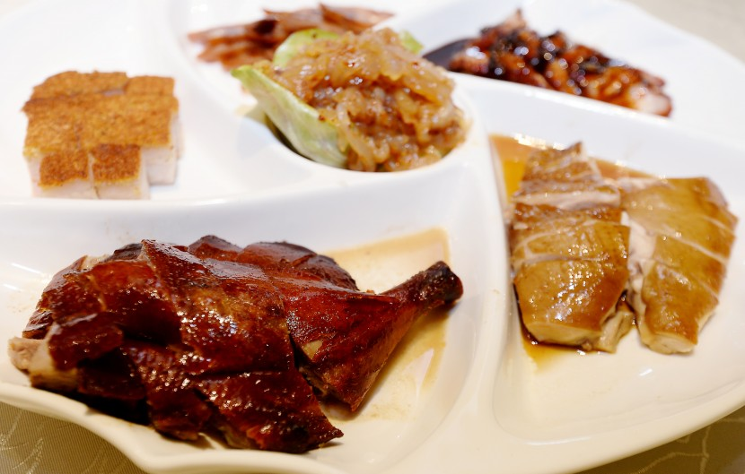 Happiness on a platter: The Six Happiness Platter has jelly fish, roasted pork belly, honey sauce char siew, soya sauce chicken, roast duck and Chinese sausages.