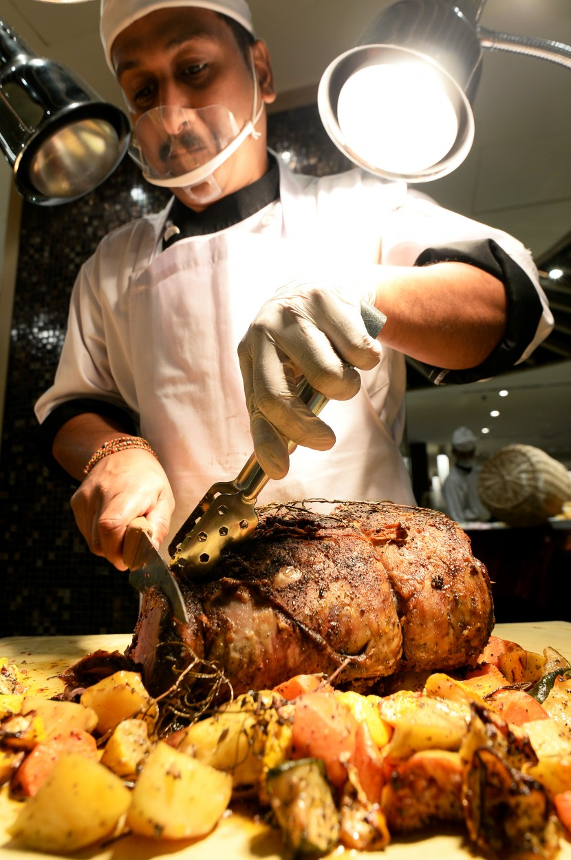 Expert hands: A chef carving succulent roast beef at the carvery station.