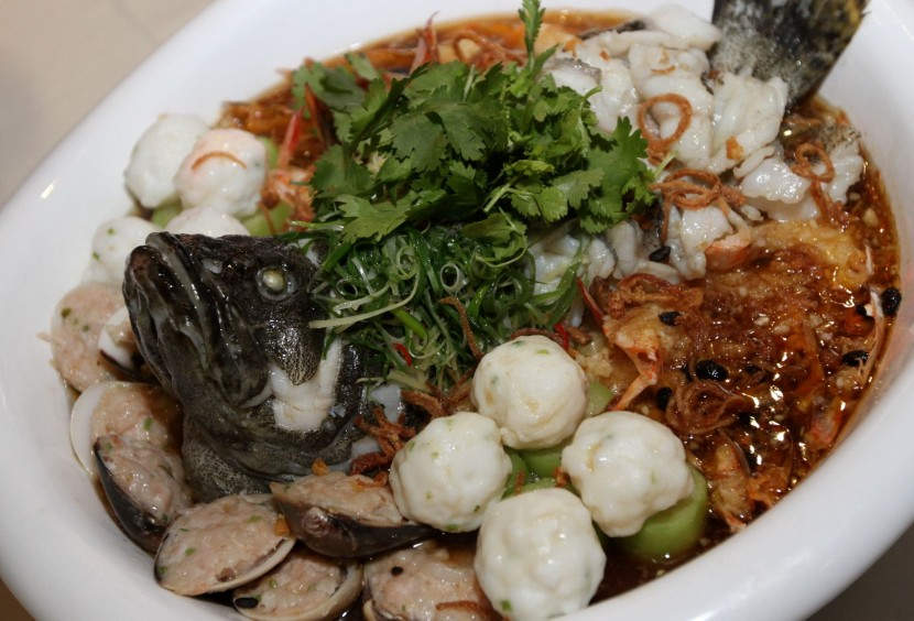 Steamed ocean garoupa fish with king prawns, stuffed clams, squid balls and 'Seng kwa'.