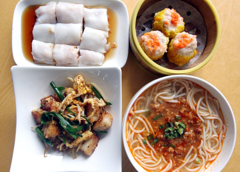 (Clockwise from bottom left) Stir-fried radish cake, prawn rice roll with fried beancurd skin, steamed siew mai and Guilin mee suah.