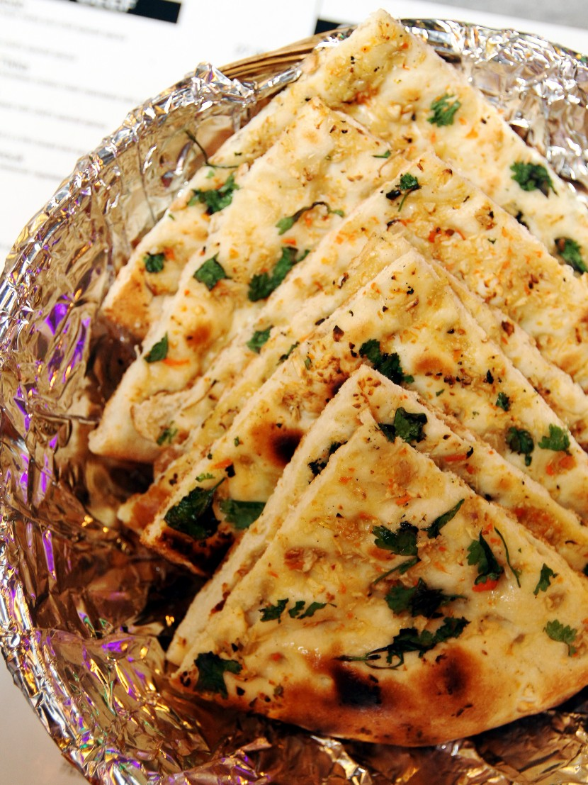 Fresh and puffy: A serving of fluffy and flavourful garlic naan bread.