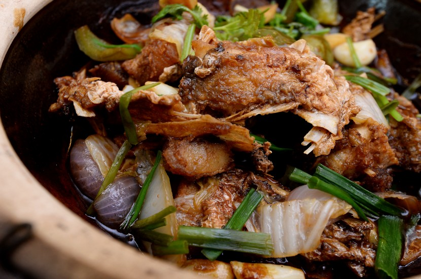 Inviting dish: The claypot fish head in soy sauce.