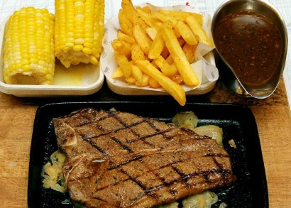 Hearty meal: The Ribeye Steak comes with a choice of Demi Glace, Black Peppercorn, Caramelised Onions or Button Mushrooms and sides of fries, mashed potatoes, mixed vegetables, coleslaw, corn or pumpkin rice.