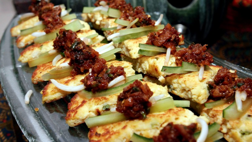 The Tauhu Telor is a staple dish in Indonesia, garnished with onion and sambal.