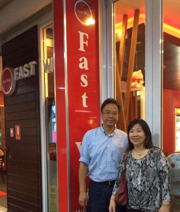 Chen and his wife, Amy Leong, outside their favourite restaurant Fast Wok in Gold Coast, Australia.