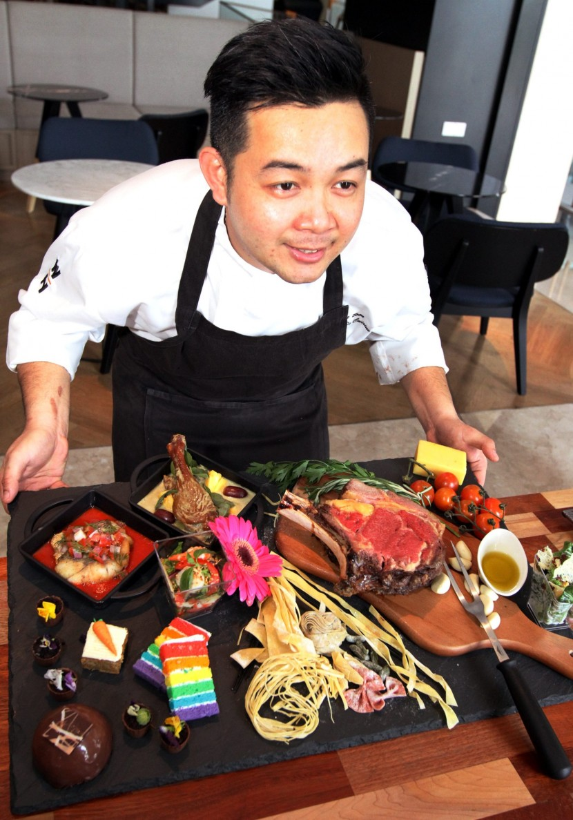Grand feast: Tiffin Restaurant Chef De Cuisine Lee Choon Boon showing off the array of food available in their upcoming Mothers Day dinner menu, which includes the Slow Oven-Roasted Beef Ribs, Pan-Seared Seabass, Thai Curry Duck, and colourful, tasty desserts.