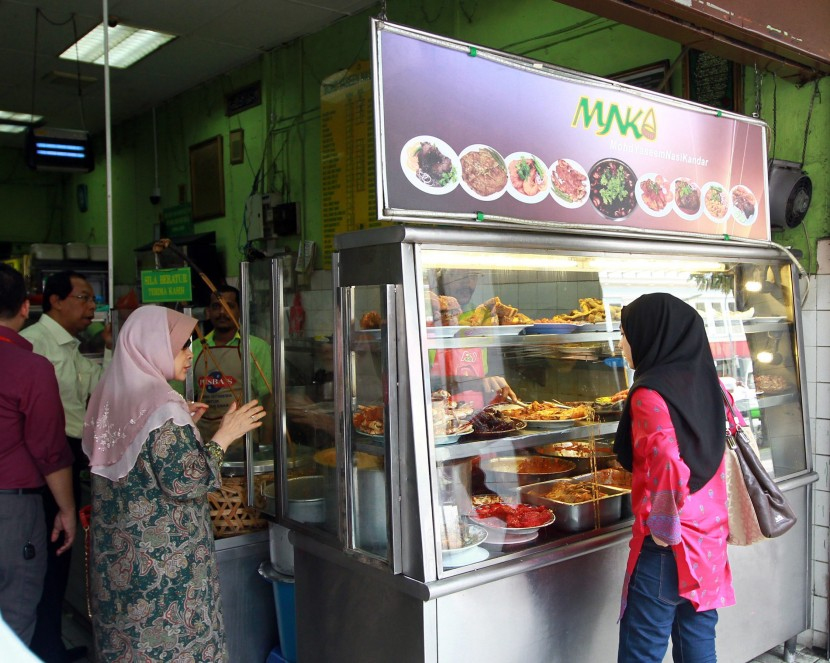 Hidden gem: Nestled between several motorcycle shops in the heart of Chow Kit, Restoran Yaseen Nasi Kandar Penang still draws its fair share of customers.