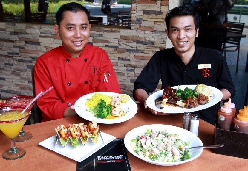 Dig in: Tony Roma's senior kitchen manager Sahril Abdul Rahman (left) presenting the dishes that are part of the promotion.