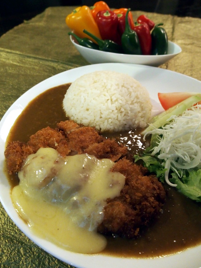 Satisfying dish: Chicken Katsu Curry Rice topped with melted cheese.