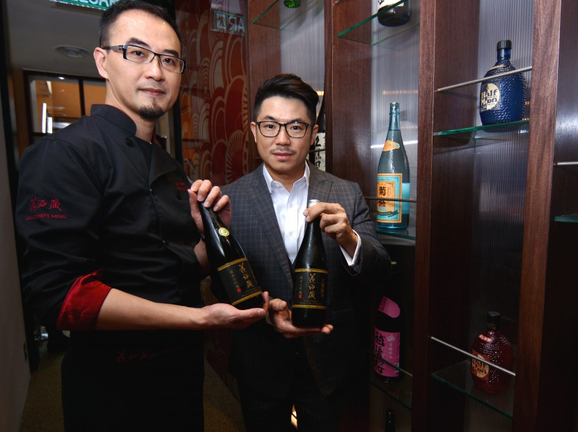 Hana Dining Sake Bar Sdn Bhd CEO Eddie Beh (right) and Aplus Dining Sake Bar Eric Hsieh showing their exclusively branded sake bottle, during the restaurant's grand opening ceremony.
