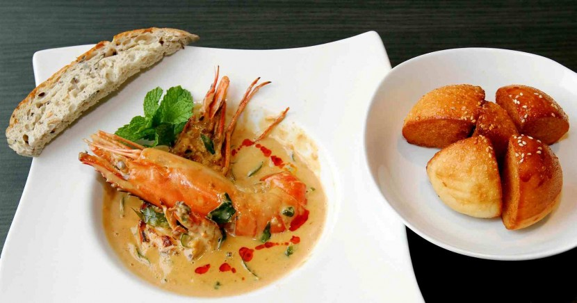 Sauteed in curry leaves and salted egg in a bird's eye chilli coconut sauce, the XL King Prawn is accompanied by a Vienna milk bun.