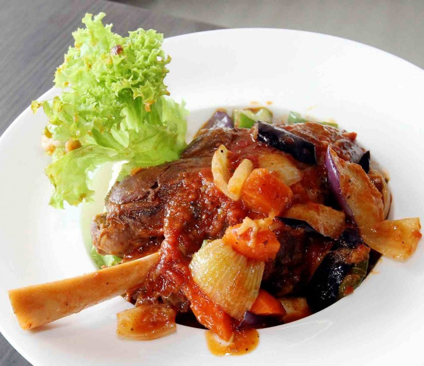 The Tuscan lamb shank is accompanied by well-seasoned ratatouille and creamy mashed potatoes.
