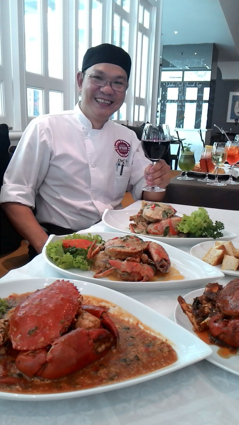Episode Chef de Cuisine Soon Yu Kong with four of the 10 crab dishes available at the restaurant.