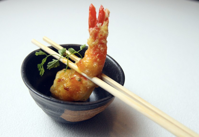 Spiced Tempura Prawns, Passion Fruit and Chilli Coulis, with the tempura prawn wrapped in sweet, slightly tangy sauce.