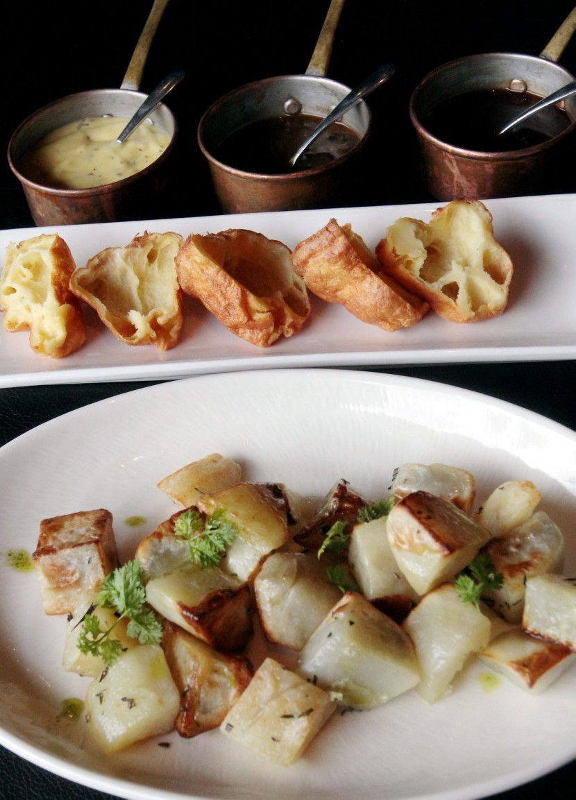 (From the top): Yorkshire pudding and roasted potatoes with accompanying sauces.