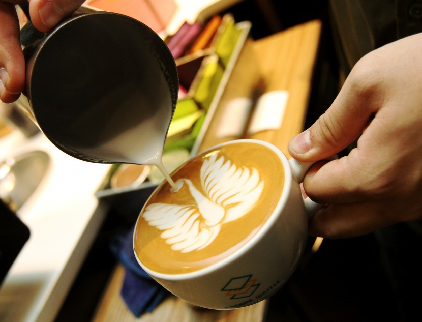 Madame Waffle operations director Chye Yuan Feng showing how to make latte art.