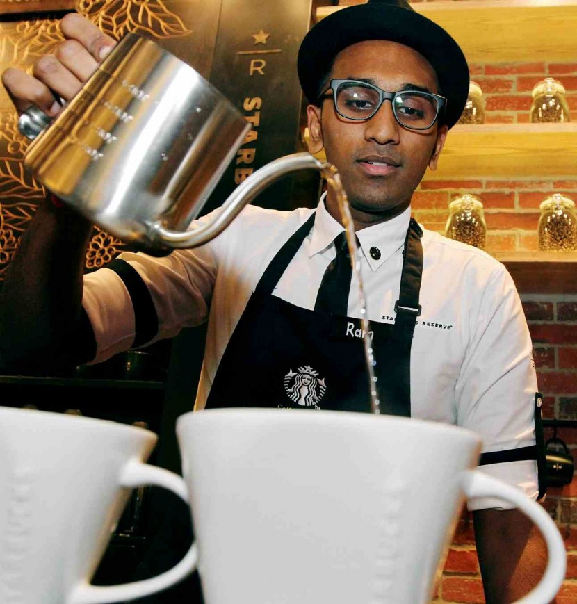 Customers can interact with the coffee masters to learn about the history and method of making Starbucks Reserve coffees.