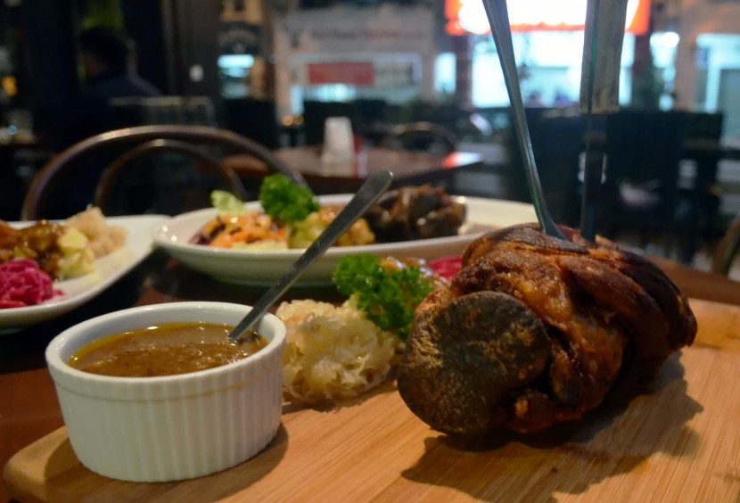 Thirsty Monkey's Roast Pork Knuckle is served with slightly toned-down sauerkraut.
