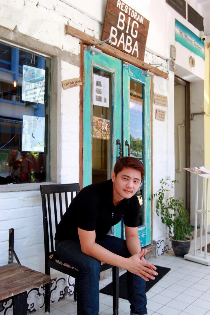 Chong sitting outside his restaurant, Big Baba.