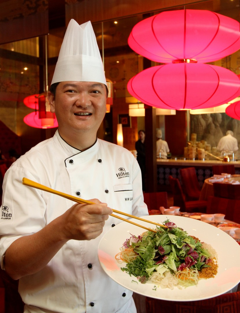 Hilton Kuala Lumpur executive Chinese chef Lam Hock Hin with the Mixed Salad with Squid Tentacles and Coconut White Curry.