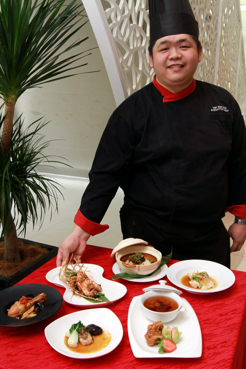 Yap showing some of the CNY signature dishes.