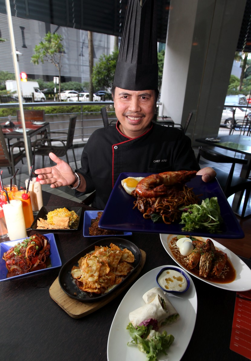 Ard showing some of the new dishes in 10 Binjai Restaurant's menu.