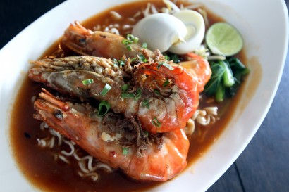 Maggi Udang Galah is served with a house-made gravy and topped with several pieces of udang galah.