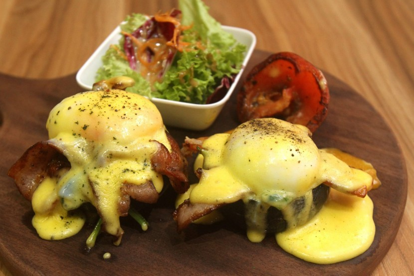 The Meyer lemon hollandaise sauce dripping off The Blackstone Benedict.