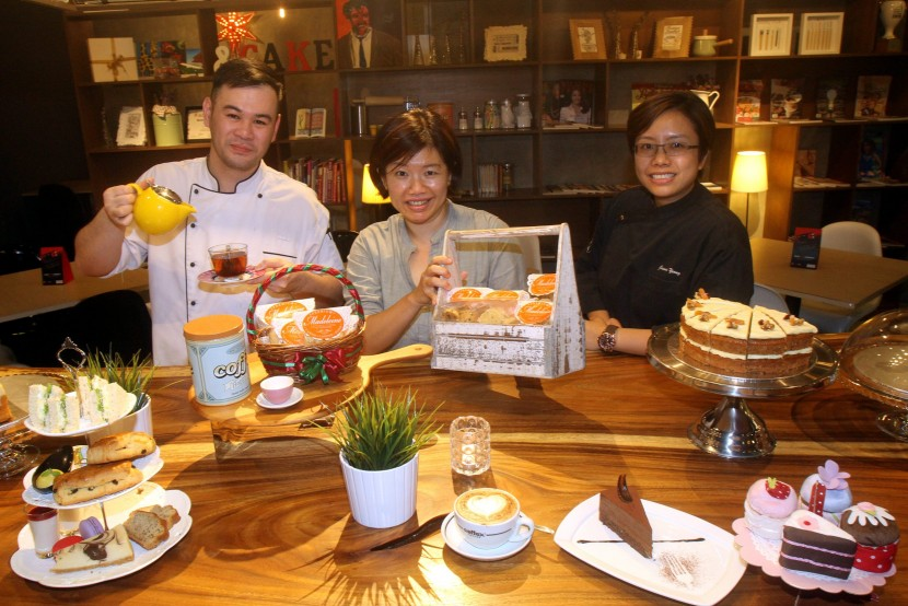 Hew (centre), flanked by Heng (left) and Yeong, are seen here at Madeleine Bistro, one of the F&B ventures under the group.