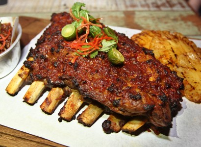 The Balinese grilled pork ribs simmered with sweet soy sauce with sambal glazing.