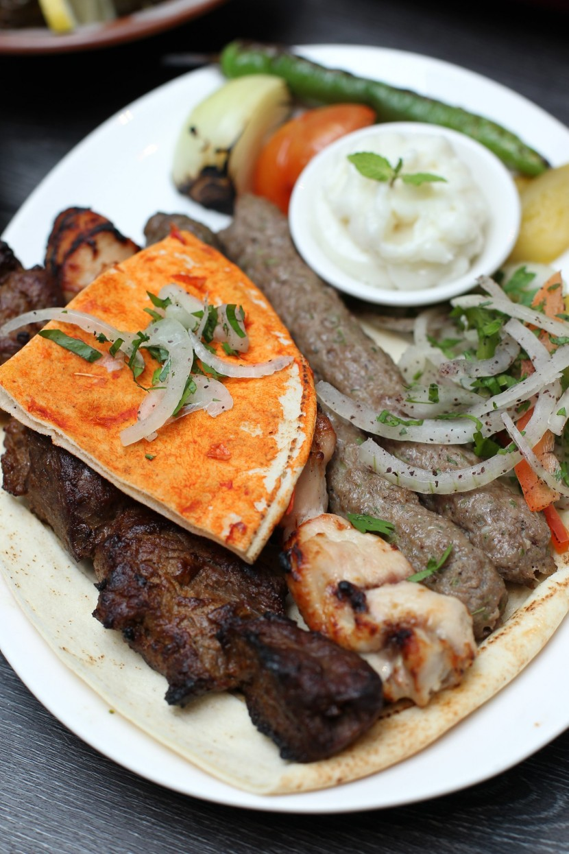 The Mixed Grill platter consisting of lamb, chicken and beef skewers, served with the special garlic paste.