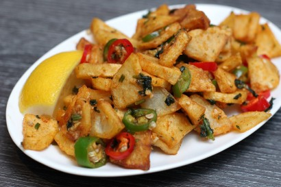 The batata harra is fried potato cubes topped with chili powder, garlic, coriander and lemon juice.