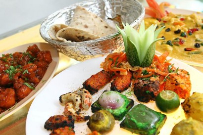 Chapati can be paired with a selection of dishes like Gobi Manchurian, a platter of mock meat and vegetables, and Navaratan Kurma