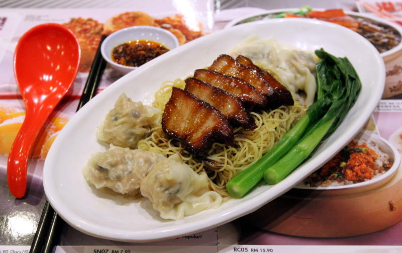 Signature dish-Hong Kong noodles with pork char siew and dumplings, freshly roasted and wrapped in-house.