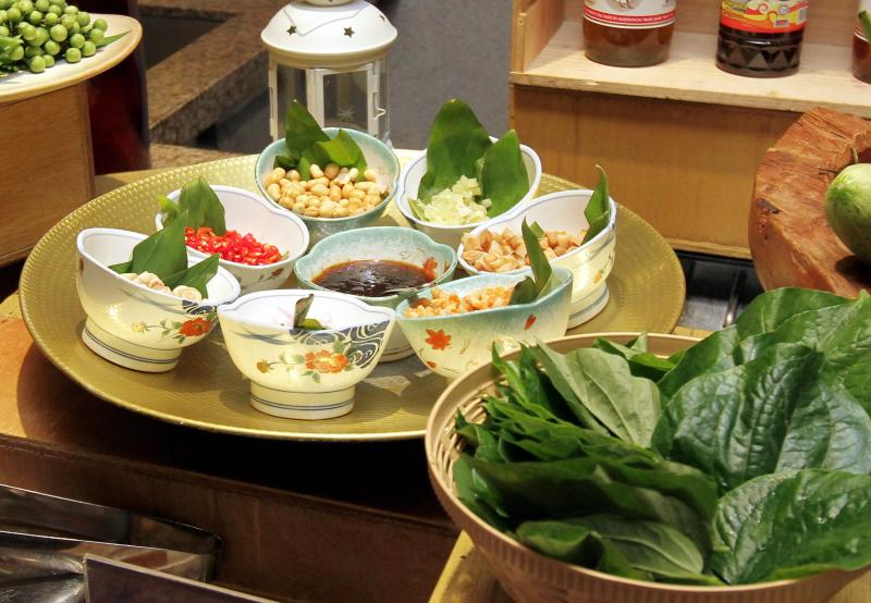 Some Thai favourites to look out for is the Traditional Wrapped Betel Leaves with Condiments (Miang Kham).
