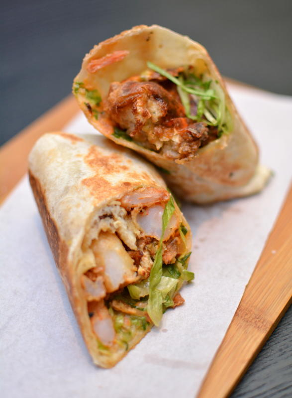 The Black Pearl Burrito is stuffed with prawns, soft shell crab and fish fillets.
