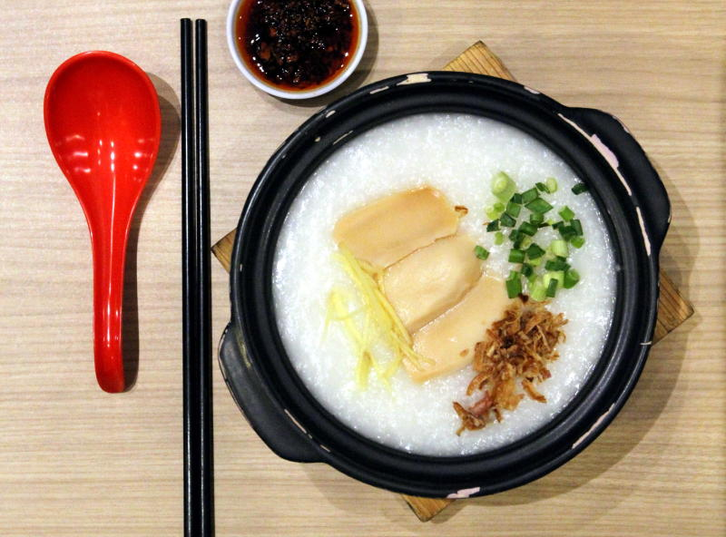 The super-smooth porridge with mock abalone, fish and prawn