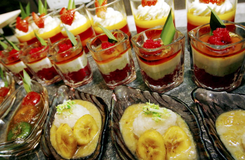 An array of traditional desserts including pengat pisang (front right), puteri mandi (front left), lompat tikam (centre), as well as puddings are on the dessert menu at Roselle Coffee House this Ramadan.