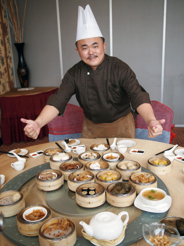 Chef Ho presenting some of the dim sum dishes available at San Feng Chinese Restaurant.
