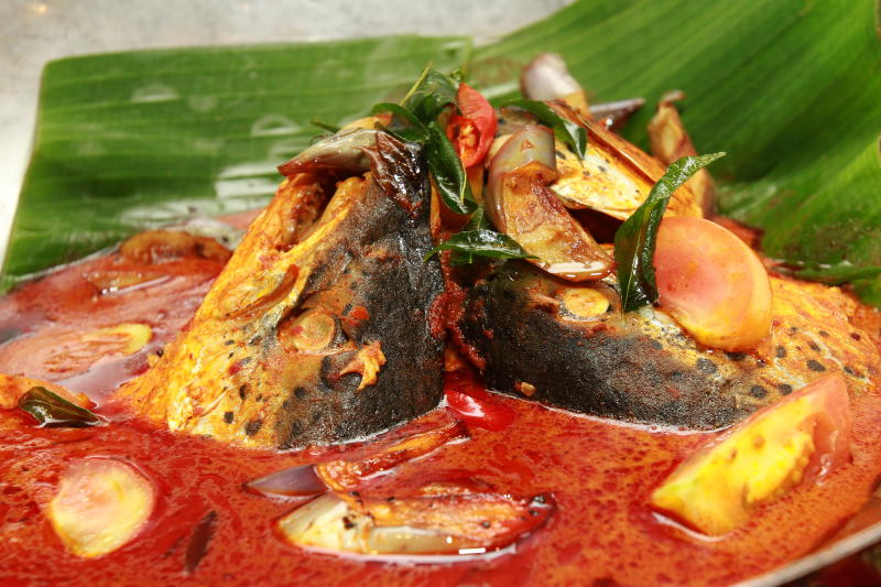 Fish head curry cooked with salmon fish.