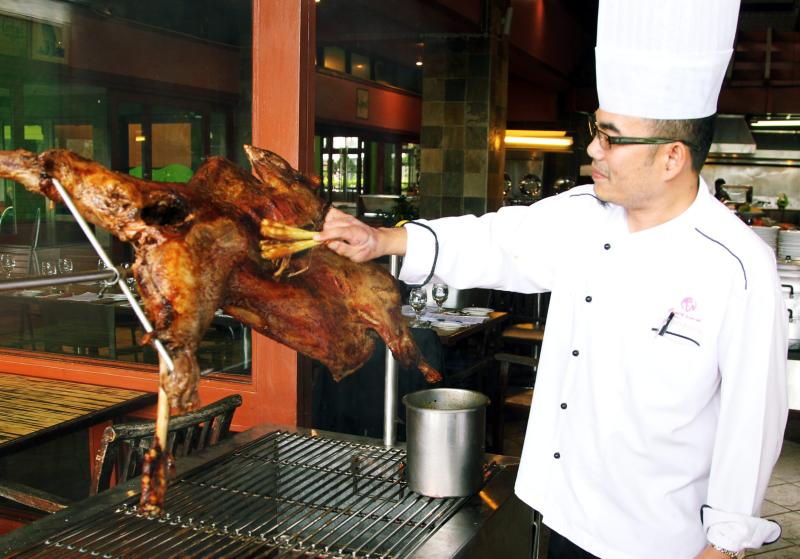 Rajawali sous chef Ahmad Rosnie Mohamed Nor basking the grilling lamb with a special marinade sauce.