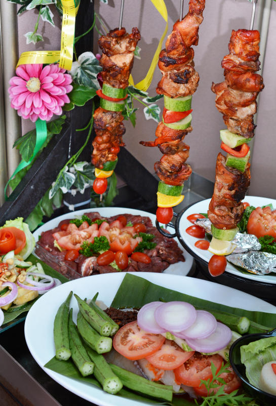 Savour grilled items like Tandoori Chicken Kebabs (top), Curry Marinated Lamb Chops (middle left), Portuguese Fish in Foil (middle right), and Daging Lada Hitam (bottom).