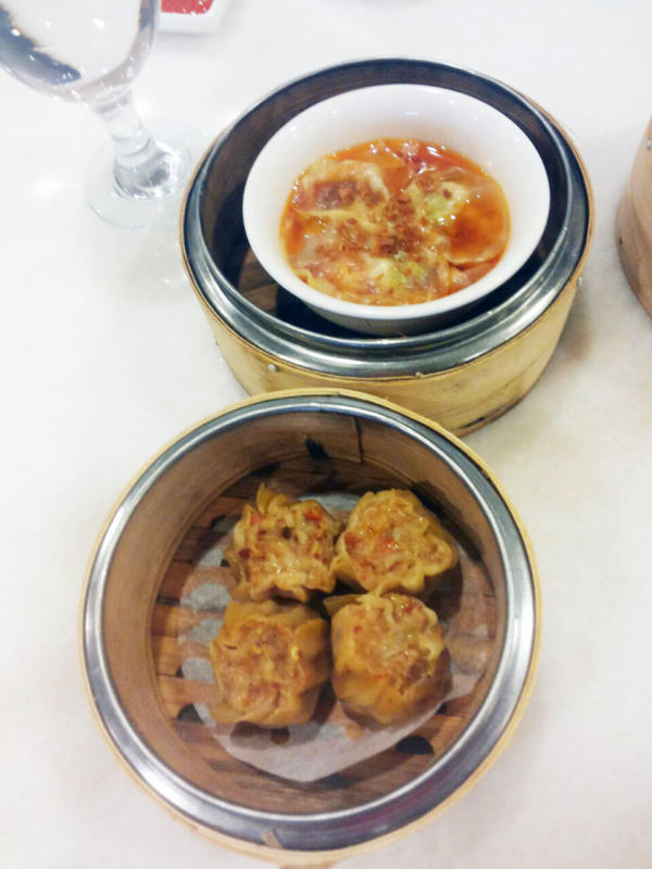 Specialty dim sum dishes Szechuan chilli oil prawn dumplings (top) and steamed Szechuan chicken dumplings (bottom).